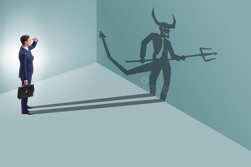 Diablo que oculta en el hombre de negocios - concepto del alter ego imágenes de archivo libres de regalías