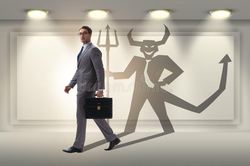 Diablo que oculta en el hombre de negocios - concepto del alter ego foto de archivo libre de regalías