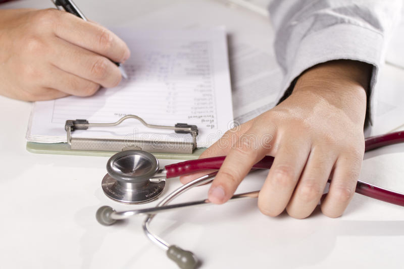 Diagnose note. A doctor write down patient stock images