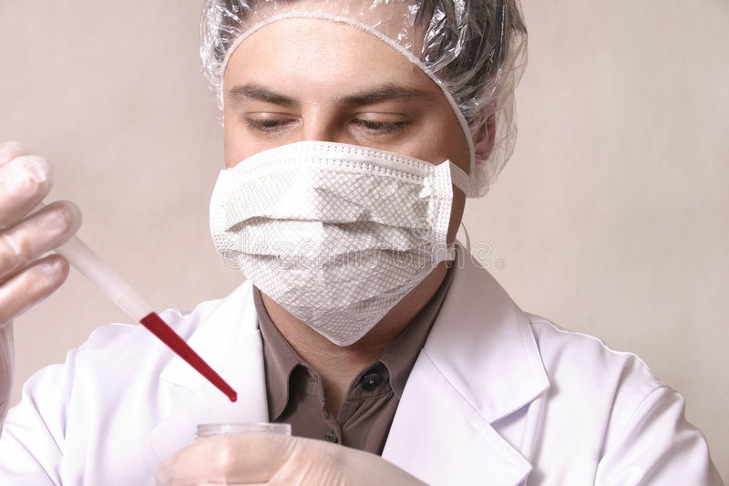 Diagnosis. Dcctor or scientist with a sample royalty free stock images