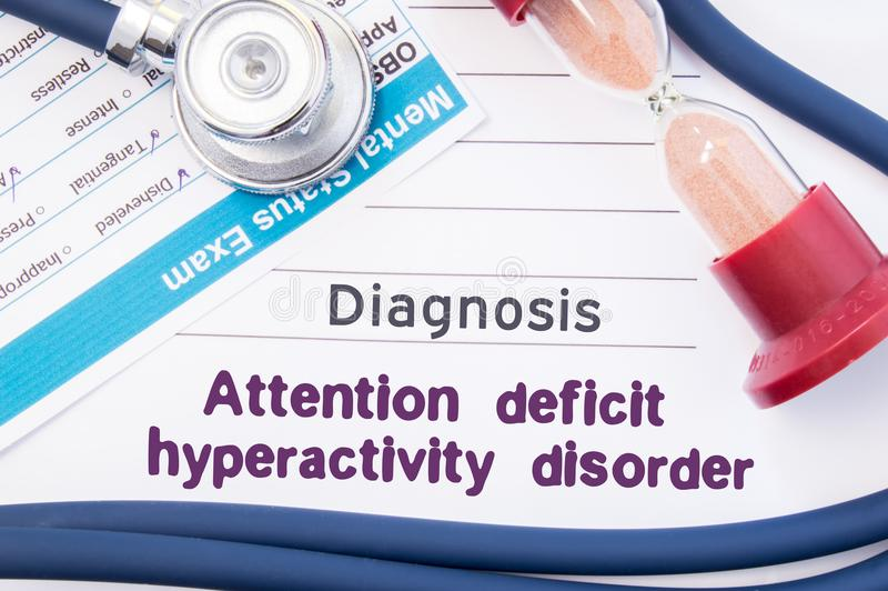 Diagnosis of Attention deficit hyperactivity disorder ADHD. On psychiatrist table is paper with title Attention deficit hyperact royalty free stock photo