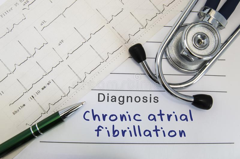 Diagnosis of Chronic atrial fibrillation. Stethoscope, green pen and electrocardiogram lie on medical form with diagnosis of Chron. Ic atrial fibrillation on the royalty free stock photography