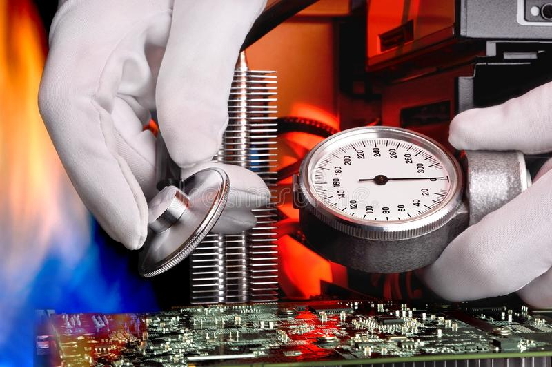Diagnosis of the computer from overheating with a stethoscope royalty free stock image