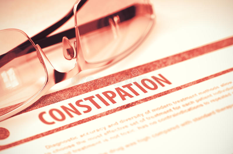 Diagnosis - Constipation. Medical Concept. 3D Illustration. Diagnosis - Constipation. Medical Concept with Blurred Text and Glasses on Red Background. Selective royalty free stock photo