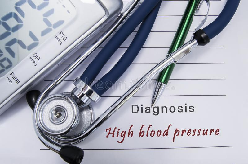 Diagnosis High blood pressure. Stethoscope and electronic sphygmomanometer lie on medical paper form with cardiac diagnosis High b stock photo