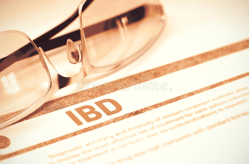 Diagnosis - IBD. Medical Concept. 3D Illustration. IBD - Inflammatory Bowel Disease - Printed Diagnosis with Blurred Text on Red Background with Glasses royalty free stock photo