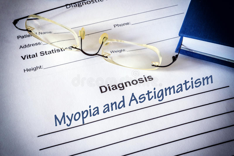 Diagnosis list with Astigmatism and myopia. Eye disorder concept royalty free stock photography