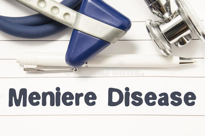 Diagnosis of Meniere Disease closeup. Medical book guide for doctor neurologist with heading text of inner ear disorder Meniere Di stock photos