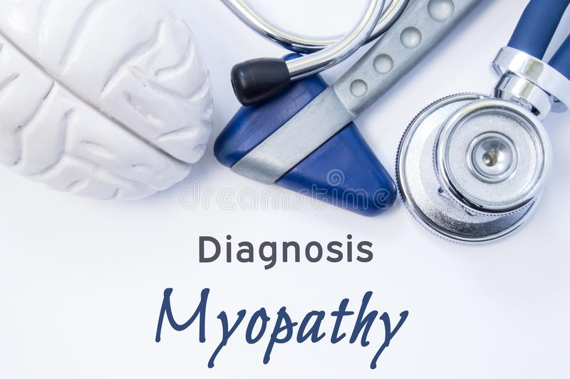 Diagnosis of Myopathy. Anatomical brain figure, neurological hammer and stethoscope lying on sheet of paper or book with the title royalty free stock photos