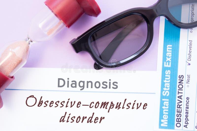 Diagnosis of Obsessive Compulsive Disorder. Hourglass, doctor glasses, mental status exam are near inscription Obsessive-Compulsiv royalty free stock image
