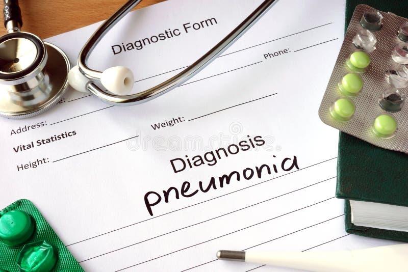 Diagnosis pneumonia and stethoscope. stock photos
