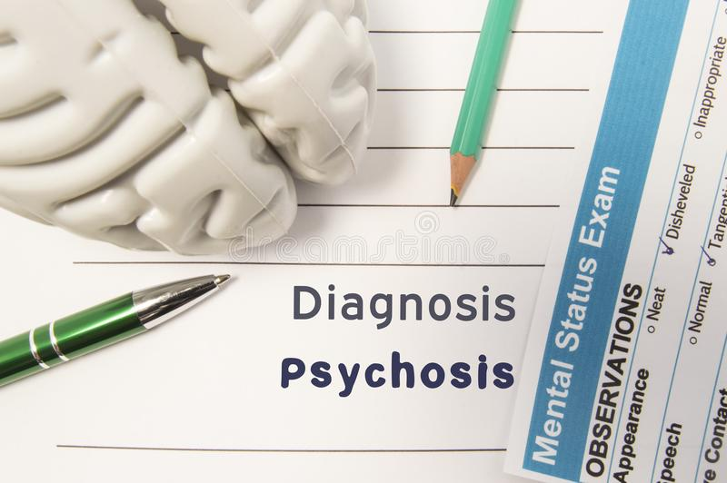 Diagnosis Psychosis. Figure of human brain, result of mental status exam, pen and pencil surrounded written psychiatric diagnosis royalty free illustration
