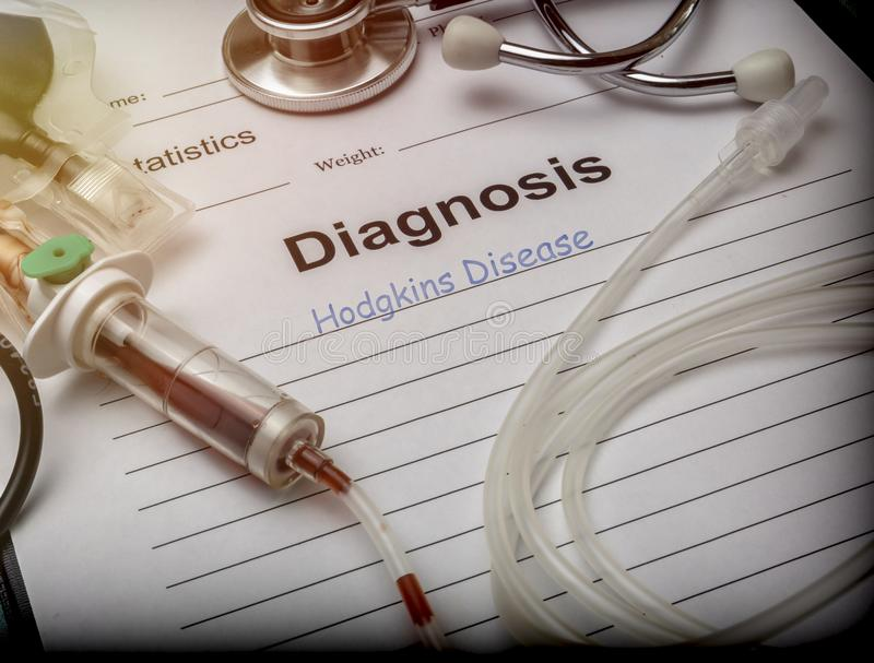 Diagnostic form, hodgkins disease, drip irrigation equipment with traces of blood in a hospital royalty free stock photos