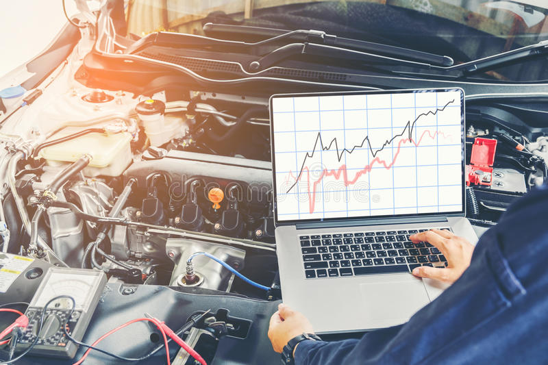 Diagnostic machine tools ready to be used with car.  royalty free stock photo