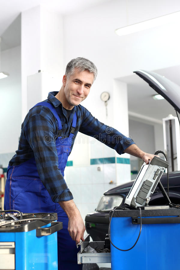 Diagnostic station, mechanic connected diagnostic computer. Car in diagnostic station, mechanic connected device royalty free stock photos