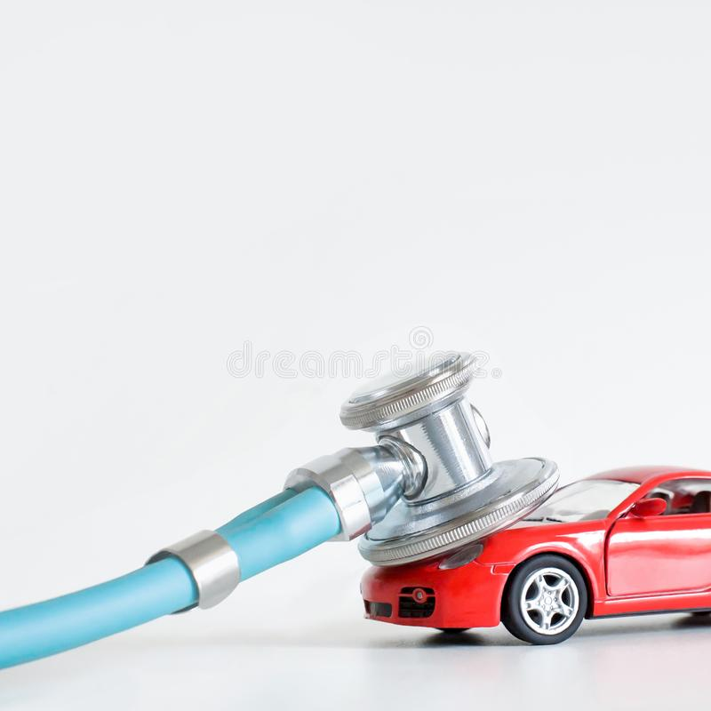 Diagnostics and car repair, stethoscope, inspection, repair and maintenance stock photo