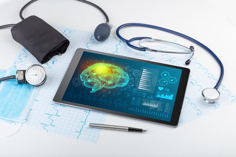 Diagnostics on tablet with brain functionality concept. Brain functionality report with medical devices aroundn royalty free illustration