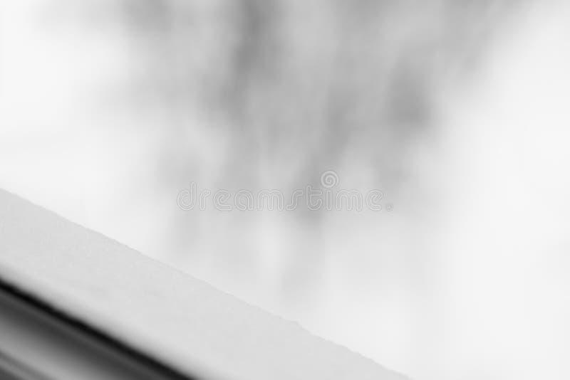 Diagonal black and white winter windowsill bokeh background. Hd royalty free stock images