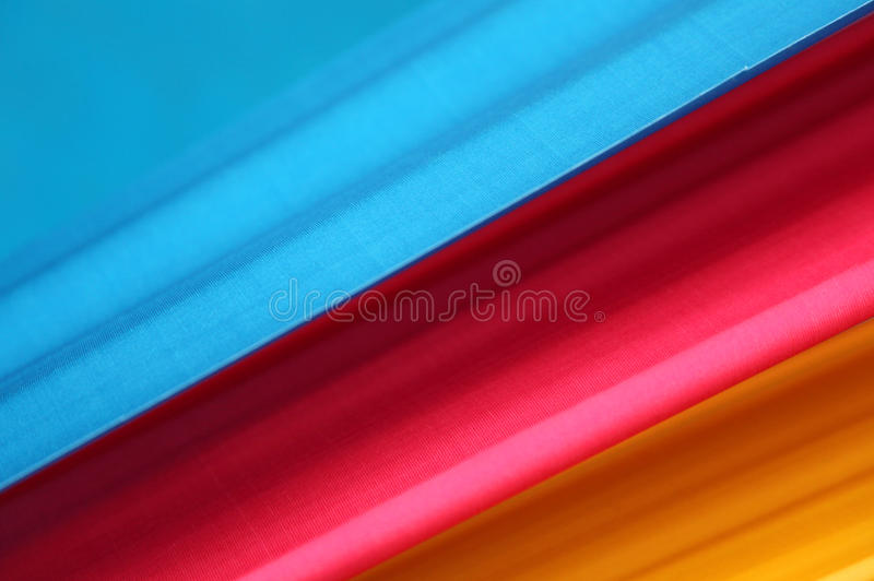 Diagonal color bands of blue red and yellow stock photography