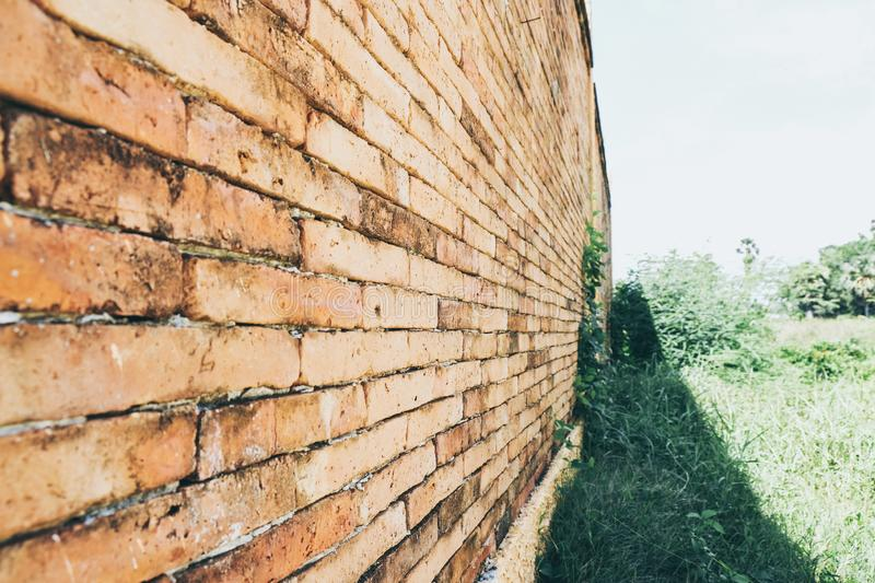 Diagonal corner of old red brick wall, wallpaper texture background stock photo