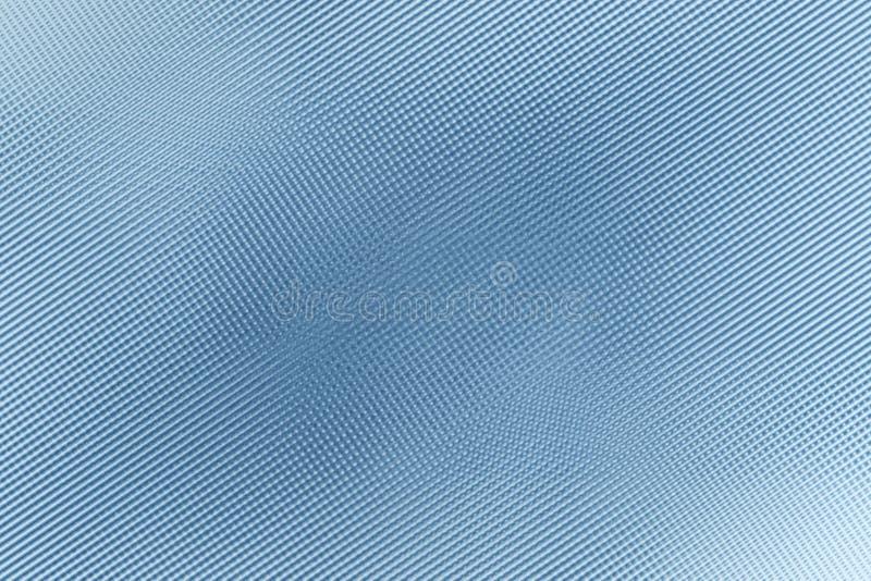 Diagonal linje struktur på den blåa plast- väggen, abstrakt bakgrund royaltyfri foto