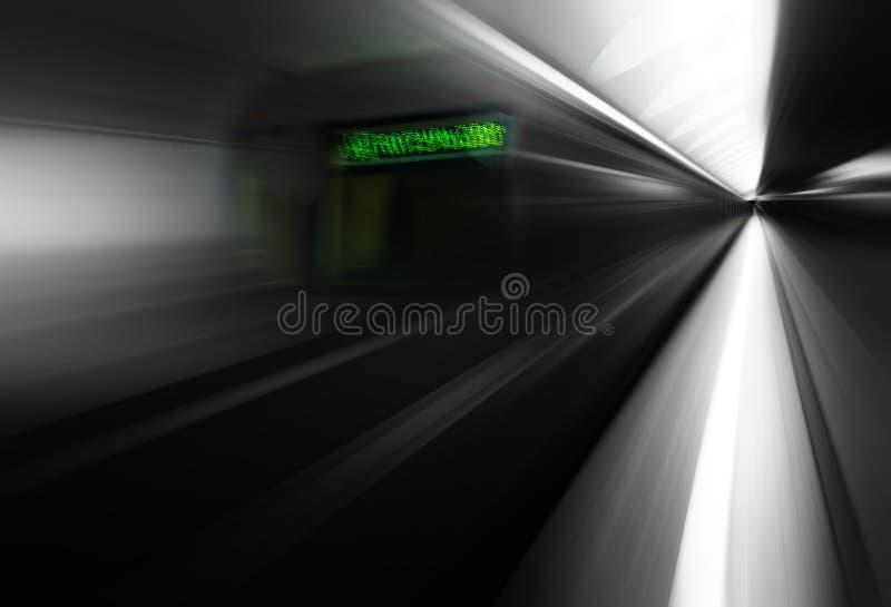 Diagonal motion blur metro train with green board background. Orientation vivid vibrant bright color rich composition design concept element object shape stock photo
