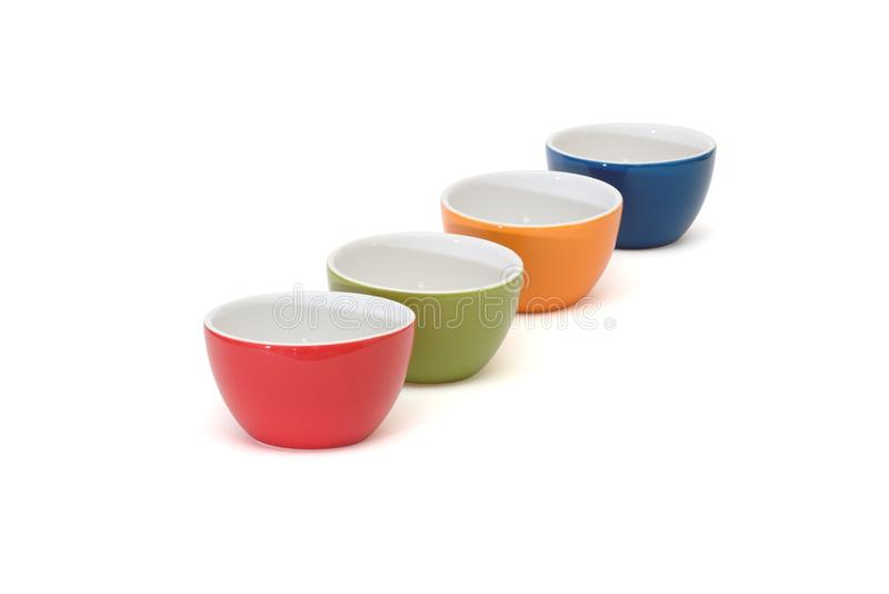 Diagonal Row Of Four Porcelain Bowls Isolated Stock Photo
