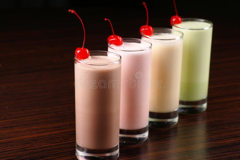 Diagonal row of milkshake cocktails stock photos