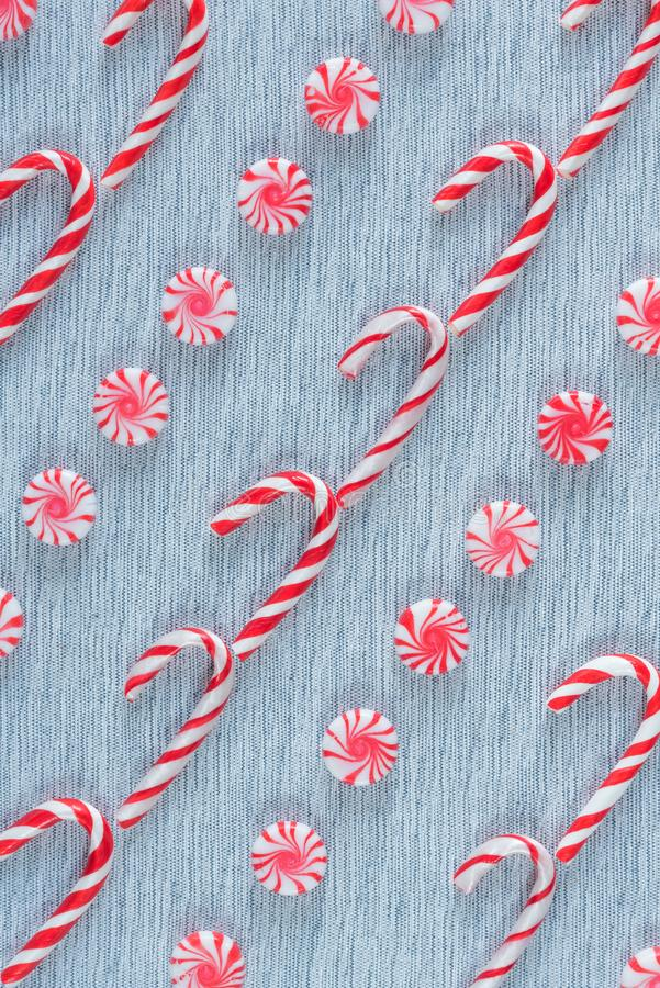 Diagonal rows of Christmas candy canes and peppermint swirl candies flay lay arrangement stock photos