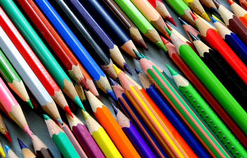 Diagonal rows of a coloured pencils royalty free stock image