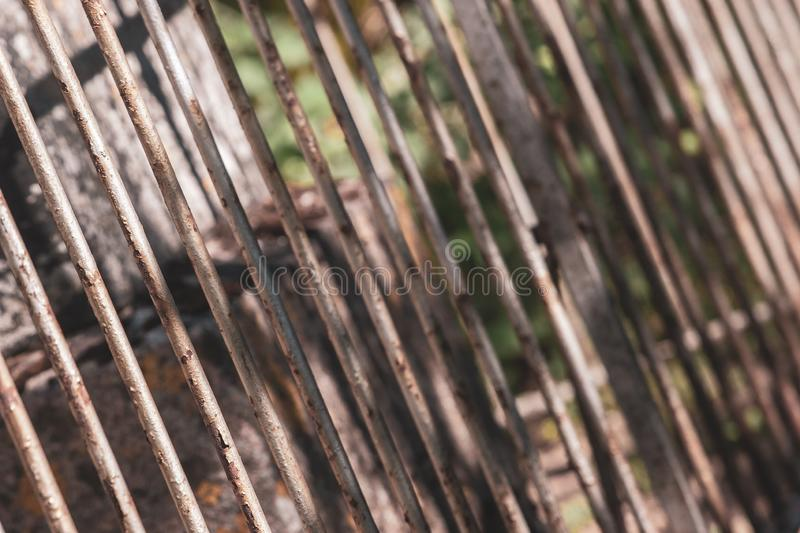 Diagonal shot of an old rusty steel bar fence. royalty free stock photography