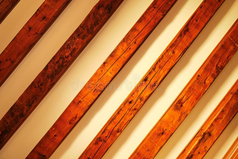 Diagonal timber pattern on beige background with gradient shadows. Wooden ceiling as abstract rustic grid background royalty free stock photos