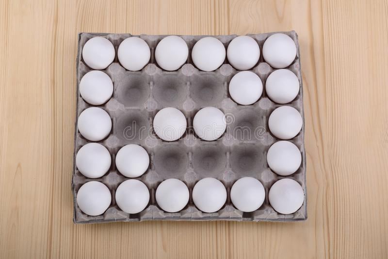Diagonal of white chicken eggs stock image
