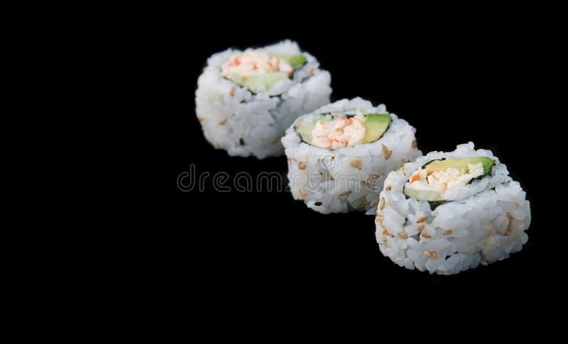 Diagonale de sushi sur le noir photos libres de droits