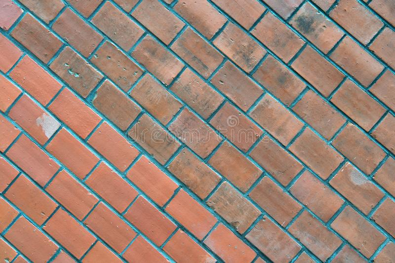 Diagonally layered red brick wall texture background. Building material concept. Industrial background empty grunge. Urban warehouse brick wall. Surface on royalty free stock photos
