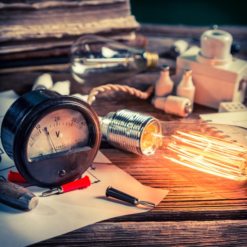 Diagram, Edison light bulb and electrical components in classroom stock images