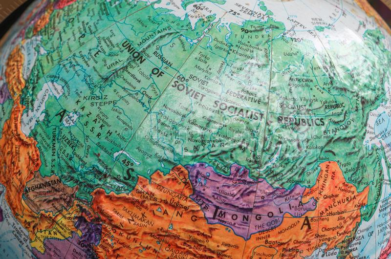 Old Print Map,terrestrial globe,Russia. A diagrammatic representation of an area of land or sea showing physical features, cities, roads, etc royalty free stock photos
