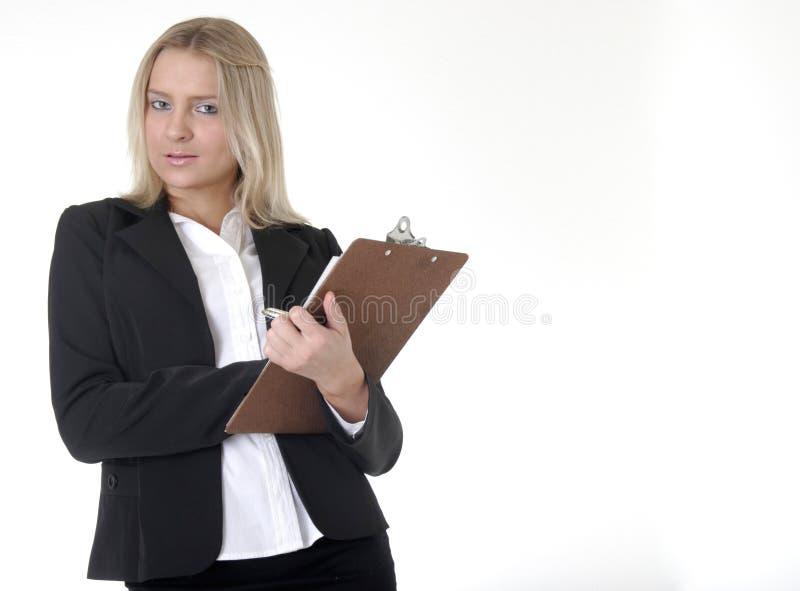 Diagramme de fixation de femme d'affaires prenant des notes photos stock
