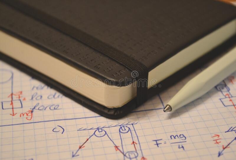 Diagrams and book with pen royalty free stock photos