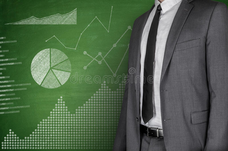 Diagrams and Businessman on Blackboard royalty free stock photos