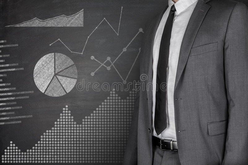 Diagrams and Businessman on Blackboard royalty free stock photo