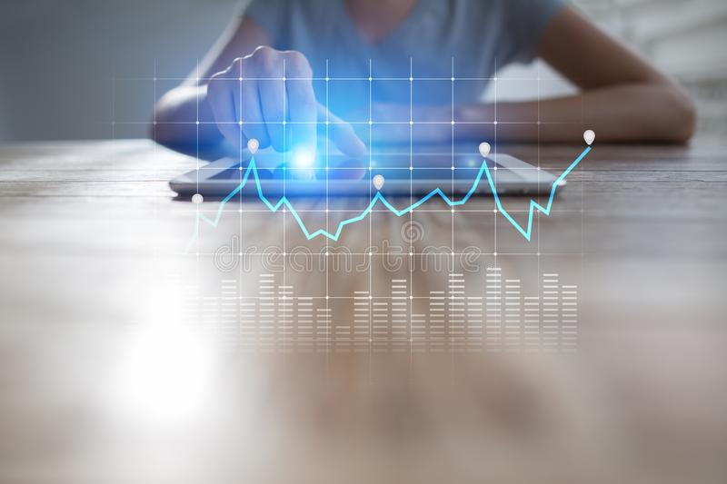 Diagrams and graphs on virtual screen. Business strategy, data analysis technology and financial growth concept. Diagrams and graphs on virtual screen. Business royalty free stock photo
