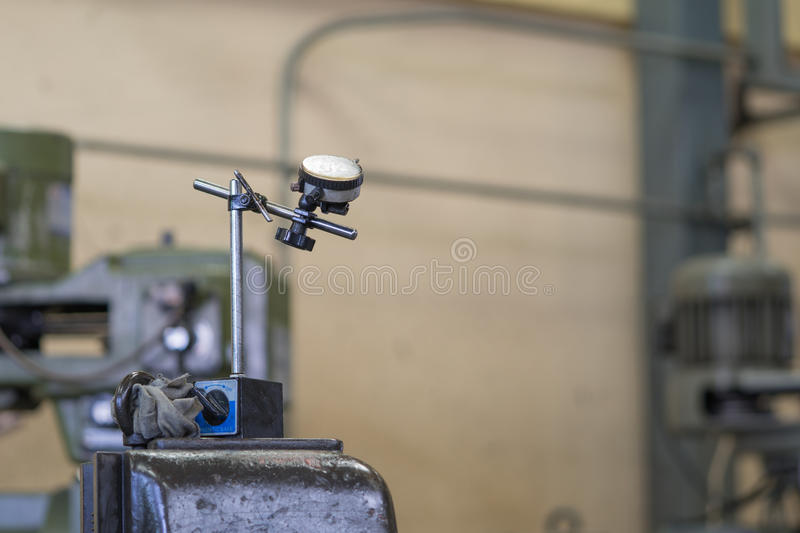 Dial indicator gauge. With factory background stock photography