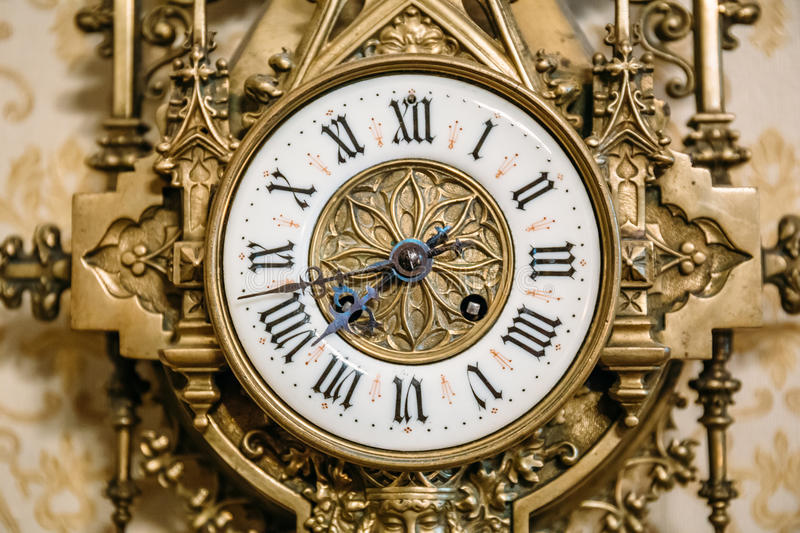 The dial of the old vintage wall clock, retro. Toned royalty free stock image