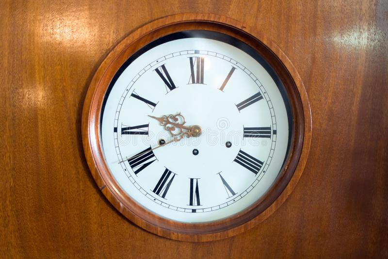 The dial of the old vintage wall clock, retro toned in a wooden frame.  stock photography