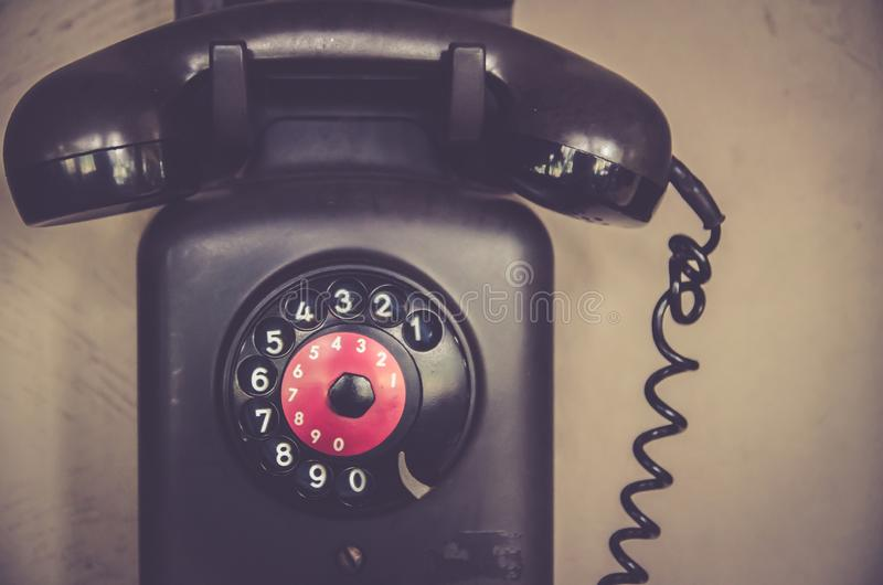Dialer and wood details of an old phone telephone, phone, antique.  stock photo