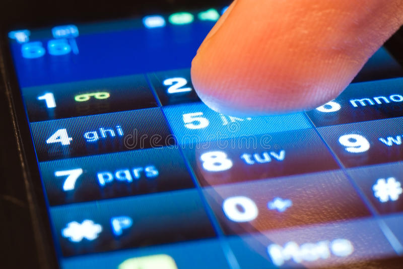Dialing on smartphone stock photo