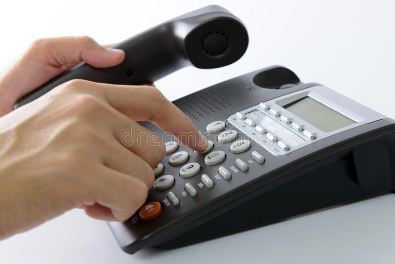 Dialing telephone stock images