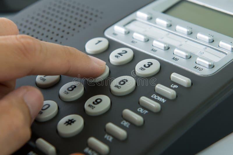 Dialing telephone stock photos
