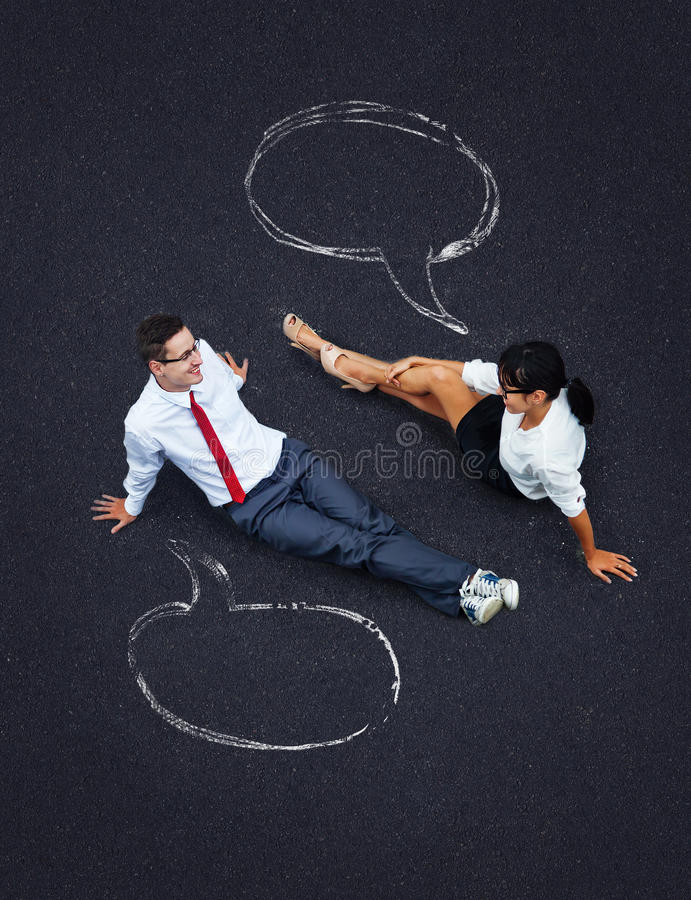 Dialog concept. Business people with speech bubbles stock photos